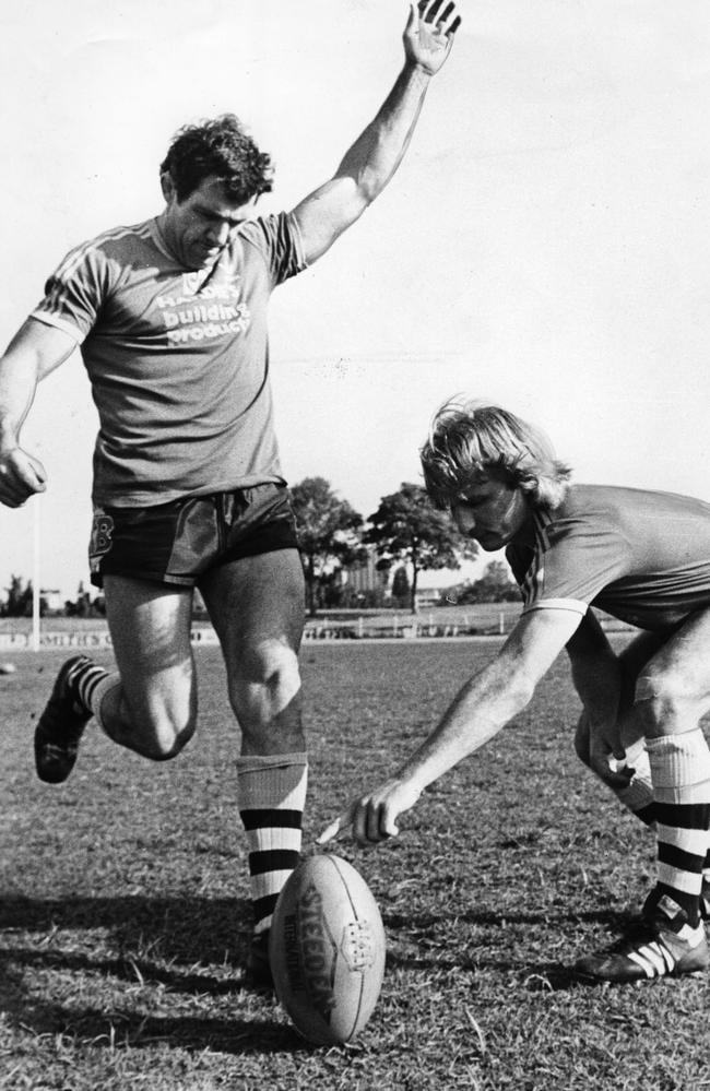 Peter Sterling holds ball for Mick Cronin whose practicing his goalkicking.