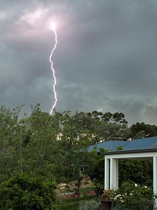 Lightning strikes the ground as storms move over Pullenvale in Brisbane's west. Picture: Grant Parker