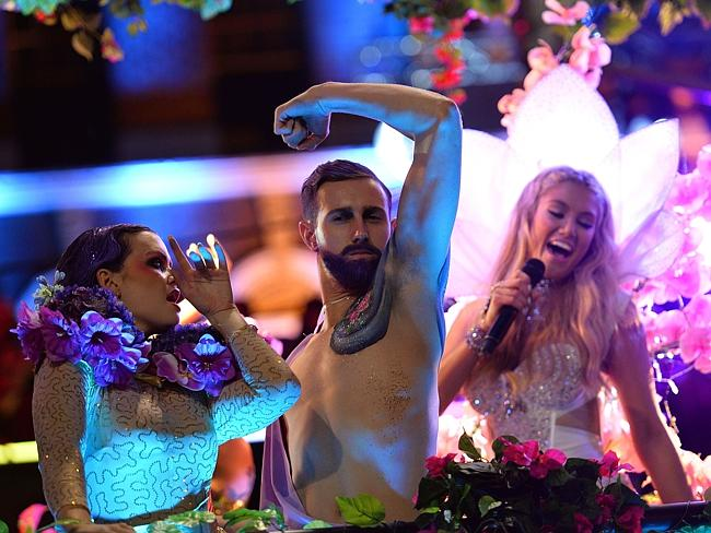 Party time ... Dancers perform as Delta Goodrem sings on a float during Sydney's Mardi Gr