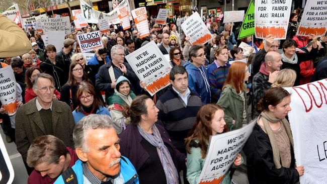 Anger ... Protesters in Melbourne march towards Parliament House. Picture: Mike Keating.