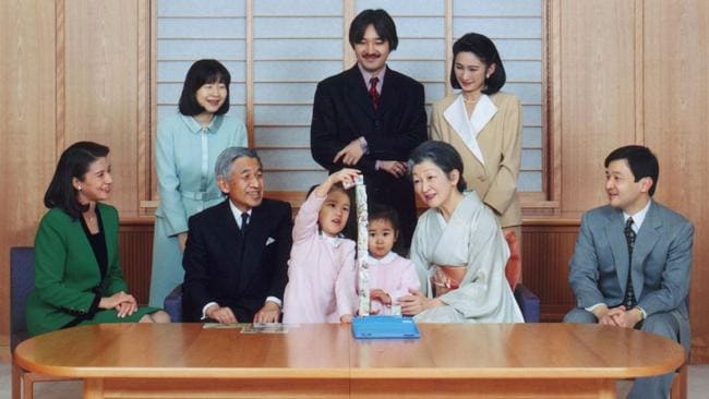 The Japanese Imperial family on New Year's Eve at the Imperial Palace in 1997. Sitting L-R: Crown Princess Masako, Japanese Emperor Akihito, his granddaughters Princess Mako and Princess Kako playing blocks, Empress Michiko and Crown Prince Naruhito. Standing L-R: Princess Nori, Prince Akishino and Princess Kiko.