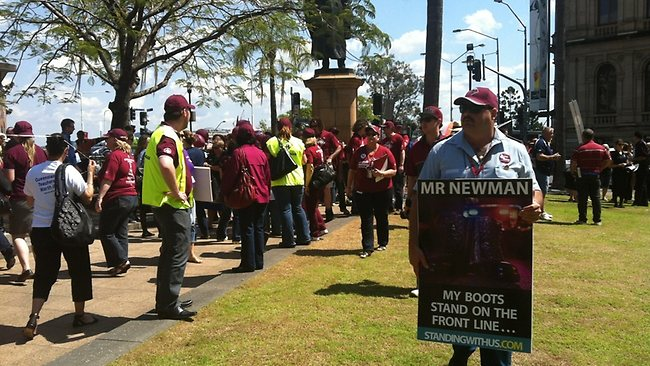 Public servants and blue-collar workers congregate in Brisbane's CBD to protest against sweeping job cuts.