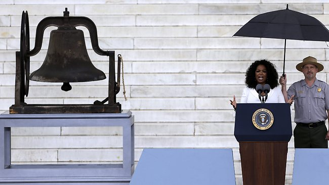 "Oprah Winfrey speaks at the Let Freedom Ring ceremony at the Lincoln Memorial in Washington, Wednesday, Aug. 28, 2013, to commemorate the 50th anniversary of the 1963 March on Washington for Jobs and Freedom. It was 50 years ago today when Martin Luther King Jr. delivered his ""I Have a Dream"" speech from the steps of the memorial. The bell at left rang at the 16th St Baptist Church in Birmingham, Ala. which was bombed 18 days after the March On Washington killing four young girls. (AP Photo/Carolyn Kaster)"