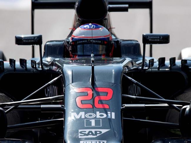 Messy first lap sees Button sidelined again