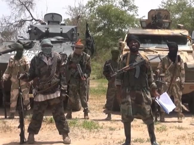 Extremists ... the leader of the Nigerian Islamist group Boko Haram, Abubakar Shekau, surrounded by loyalists.