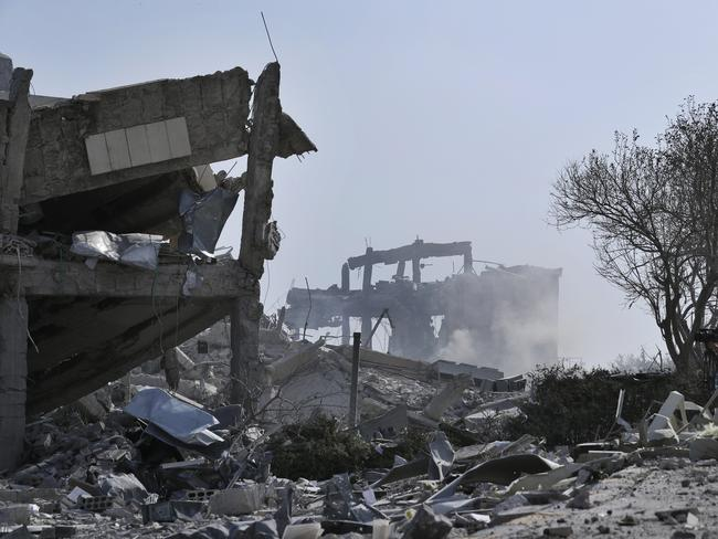 Smoke rises from the damage of the Syrian Scientific Research Centre after the air strikes.