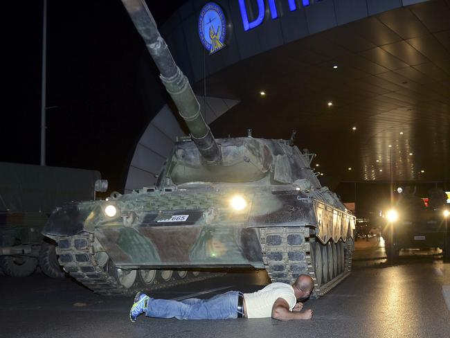 A man lies in front of a Turkish army tank at Ataturk airport in Istanbul. Picture: Reuters/Ihlas news agency