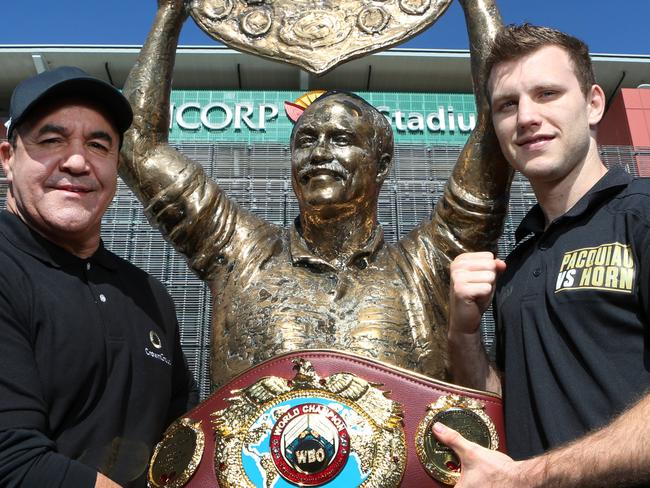 Jeff Fenech and Jeff Horn at the Wally Lewis statue outside Suncorp Stadium. Pic Darren England.