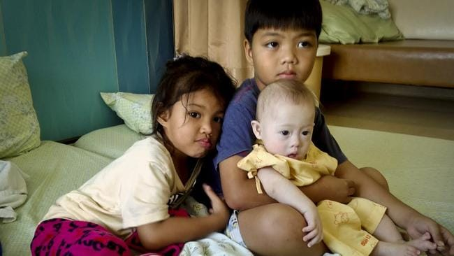 Innocent victim ... Gammy with the children of his Thai surrogate. Picture: Patrick Brown