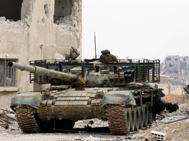 A picture taken on April 29, 2018, during a government guided tour in Damascus' southern al-Qadam neighbourhood, shows a Syrian army tank parked in a street. Picture: AFP