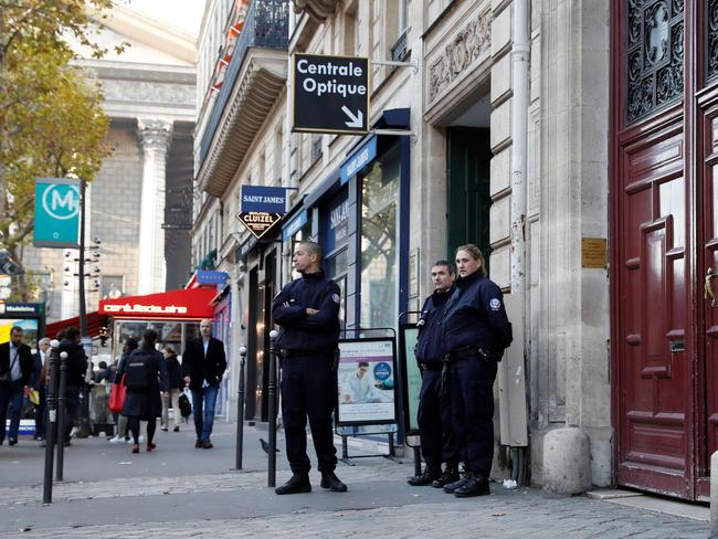 Police officers standing guard at the entrance to a hotel residence at the Rue Tronchet, near Madeleine, central Paris, where US reality television star Kim Kardashian was robbed at gunpoint. Picture: AFP