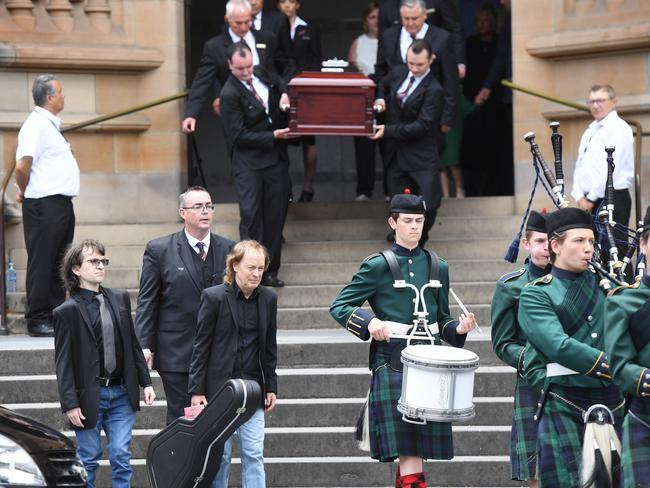 Angus Young, left, carrying the guitar. Picture: AAP
