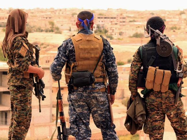 Syrian Democratic Forces fighters were targeted by a Syrian warplane, according to the US. Picture: Syrian Democratic Forces via AP