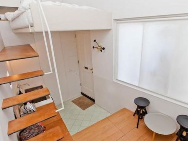 Use of space ... Stairs lead up to a mezzanine from the kitchen units. Picture: Zoopla