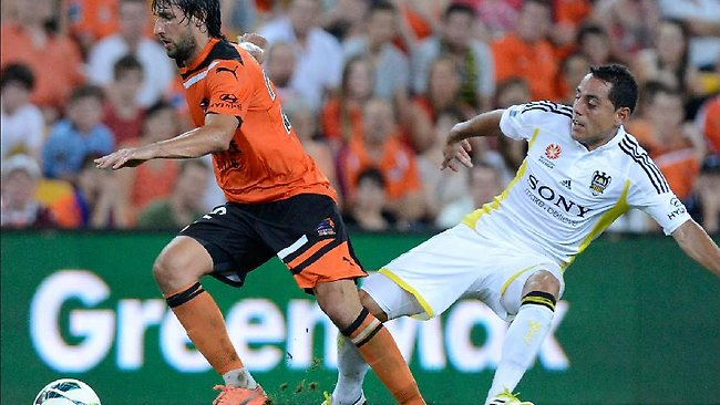 Brisbane Roar midfielder Thomas Broich skips away from the challenge of Wellington's Leo Bertos.