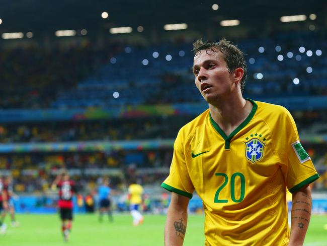 Bernard of Brazil looks dejected after the game. Can't imagine why.
