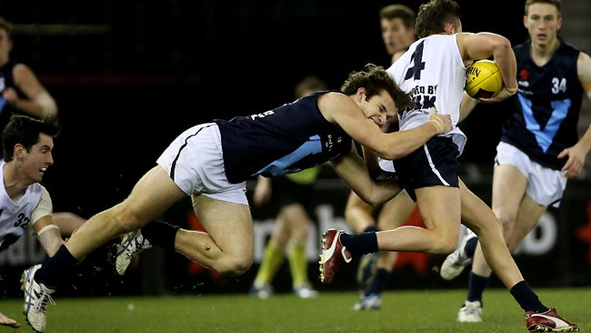 Vic Metro's Nathan Freeman tackles Billy Hartung. Picture: Colleen Petch