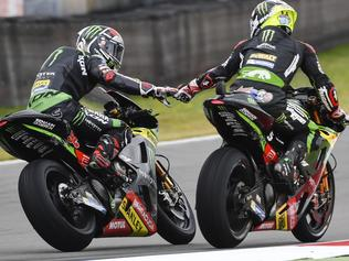 Moto GP rider Johann Marco, right, of France celebrates with teammate Jonas Folger of Germany after winning the MotoGP qualifying session ahead of the Dutch Grand Prix, in Assen, northern Netherlands, Saturday, June 24, 2017. (AP Photo/Geert Vanden Wijngaert)
