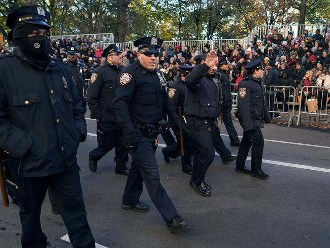 New York Police Department officers are greeted by people before the start of the Macy's Thanksgiving Day Parade in New York. Picture: AP