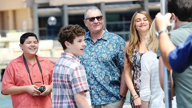 Modern Family cast members Rico Rodriguez, Nolan Gould, Ed O'Neill and Sofia Vergara film near the Park Hyatt Hotel in The Rocks. Picture Craig Greenhill