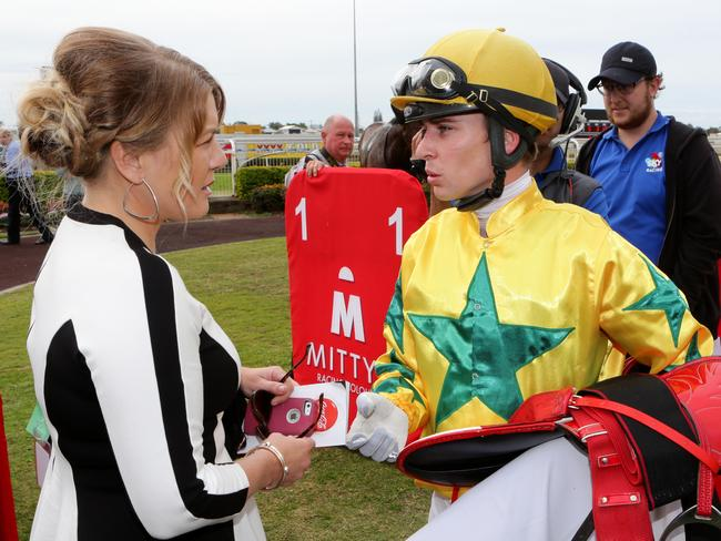 Tim Bell talks with trainer Kristie Clark-Peoples after getting home aboard Mister Booze. Picture: Darren England