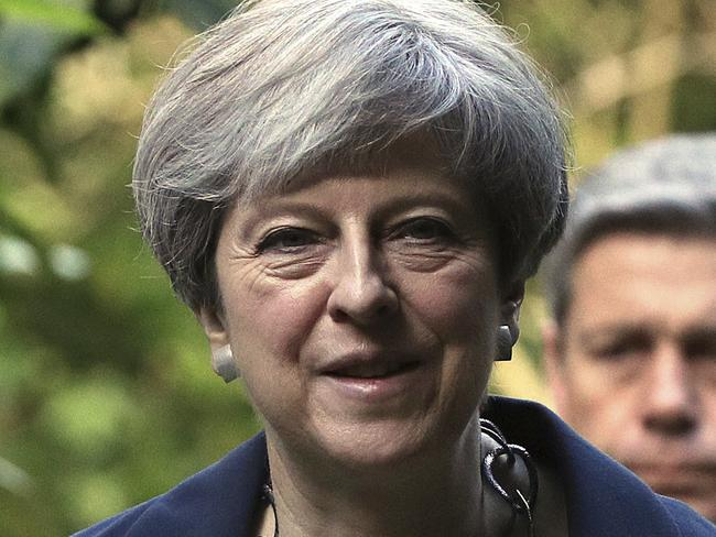 Britain's Prime Minister Theresa May was reportedly told by Mr Trump he didn't want to visit the UK. Picture: Jonathan Brady/AP