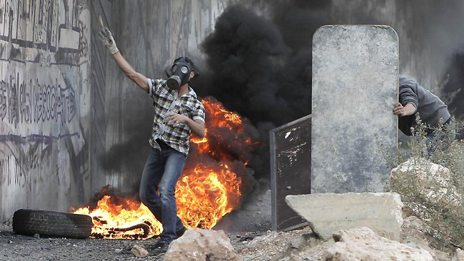 A Palestinian youths clash with Israeli soldiers at the Qalandia checkpoint, in the occupied West Bank. Picture: AFP