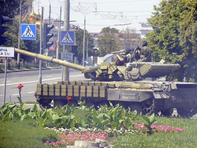 Internal conflict ... pro-Russian militants drive a tank through the eastern Ukrainian city of Donetsk as intense clashes took place between Ukrainian government troops and pro-Russian rebels. Picture: Alexander Khudoteply