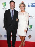 Ed Cowan and Virginia Lette on the red carpet arriving at the 2014 Allan Border Medal held at Doltone House at Hyde Park.