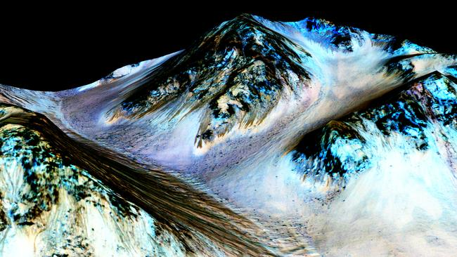 Dark, narrow streaks on Martian slopes such as these at Hale Crater are inferred to be formed by seasonal flow of water on contemporary Mars. Picture: NASA/JPL-Caltech/Univ. of Arizona