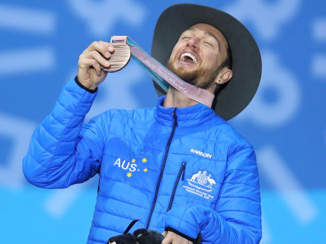 Simon Patmore celebrates at the medal ceremony after he won bronze in the snowboard banked slalom at the Winter Paralympics in PyeongChang.