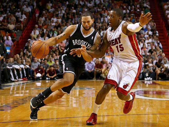 Deron Williams of the Brooklyn Nets drives on Mario Chalmers of the Miami Heat.