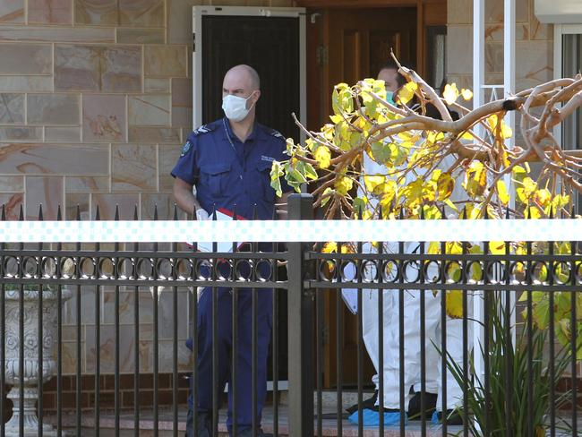 Police and Paramedics attend the scene of a murder at Rawson Street, Alberton in Adelaide yesterday. Picture Stephen Laffer