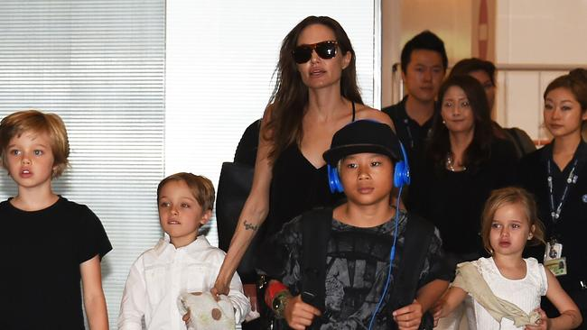 Angelina Jolie with kids (left to right) Shiloh, Knox, Pax and Vivienne arriving in Tokyo, Japan in June 2014.