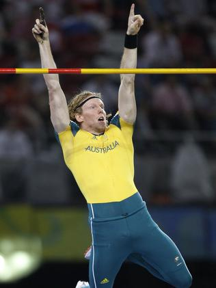 Winning moment: Hooker clears 5.80m in the 2008 men's Olympic pole vault final in Beijing. Picture: AP