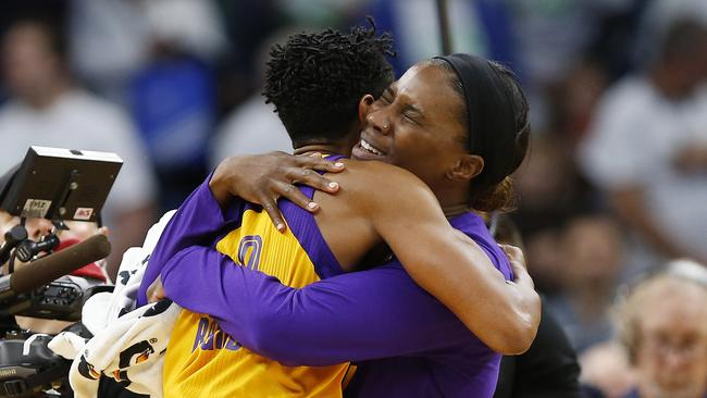 Los Angeles Sparks centre Jantel Lavender hugs guard Alana Beard after Beard hit the game winning shot in Game 1.