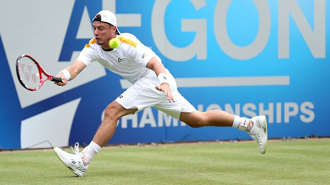Lleyton Hewitt of Australia plays a forehand shot during the Men's Singles second round match against Grigor Dimitrov of Bulgaria on day three of the AEGON Championships at Queen's Club.
