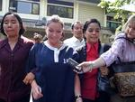 2004 - Schapelle Corby held by woman police and her lawyer Lili Srirahayu Lubis to investigation on Police HQ in Bali. Picture: Supplied