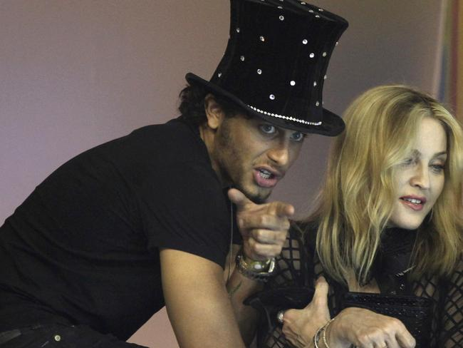 Religious couple ... US singer Madonna, right, and Brazilian model Jesus Luz in 2010.