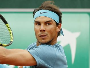 Spain's Rafael Nadal returns in his first round match of the French Open tennis tournament against Australia's Sam Groth at the Roland Garros stadium in Paris, France, Tuesday, May 24, 2016. (AP Photo/Alastair Grant)