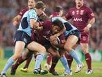 Maroons forward Sam Thaiday is wrapped up during State of Origin III.