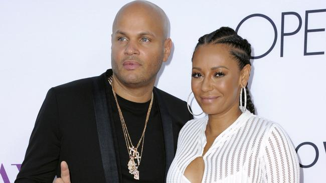 Stephen Belafonte, left, and Mel B on the red carpet. She claims she would cover up for him as the abuse continued. Picture: Richard Shotwell/Invision/AP, File)