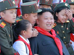 "This taken on June 6, 2017 and released from North Korea's official Korean Central News Agency (KCNA) on June 8 shows North Korean leader Kim Jong-Un (C) at a photo session with the participants in the 8th Congress of the Korean Children's Union (KCU) in Pyongyang. / AFP PHOTO / KCNA VIA KNS / STRINGER / - South Korea OUT / REPUBLIC OF KOREA OUT ---EDITORS NOTE--- RESTRICTED TO EDITORIAL USE - MANDATORY CREDIT ""AFP PHOTO/KCNA VIA KNS"" - NO MARKETING NO ADVERTISING CAMPAIGNS - DISTRIBUTED AS A SERVICE TO CLIENTS THIS PICTURE WAS MADE AVAILABLE BY A THIRD PARTY. AFP CAN NOT INDEPENDENTLY VERIFY THE AUTHENTICITY, LOCATION, DATE AND CONTENT OF THIS IMAGE. THIS PHOTO IS DISTRIBUTED EXACTLY AS RECEIVED BY AFP. /"