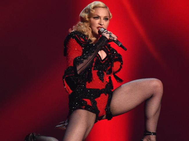 Lady in red ... Madonna performs Living For Love. Picture: John Shearer/Invision/AP