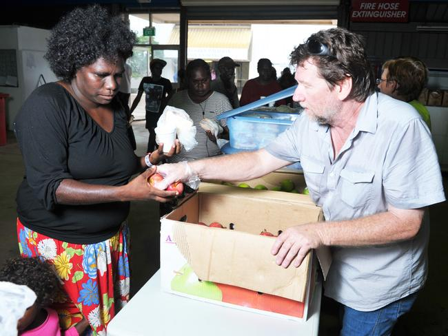 Volunteers help feed the residents of Goulburn Island after the evacuation.