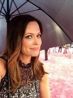 "BEHIND THE SCENES OSCARS 2014: TV presenter Angela Cox posts, ""Hard to look glam with an umbrella!"" Picture: Twitter"