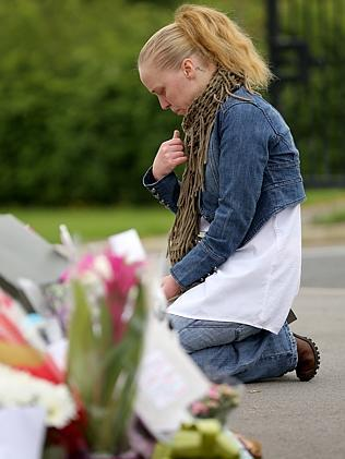 Mourning ... Amanda Gledhill, a former pupil of Corpus Christi Catholic College, grieves for teacher Ann Maguire. Picture: Christopher Furlong