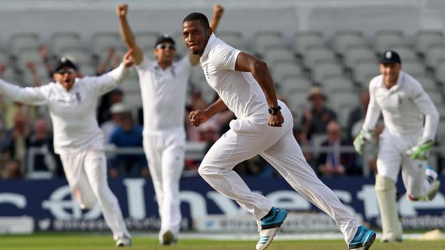 England's Chris Jordan celebrates taking the wicket of India's Pankaj Singh.