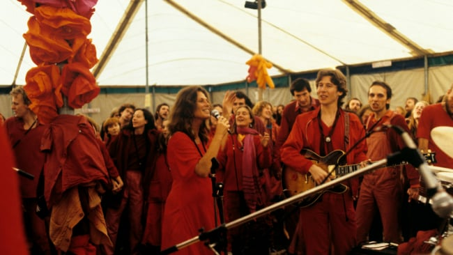 Cult followers congregating to play music. Photo: Getty