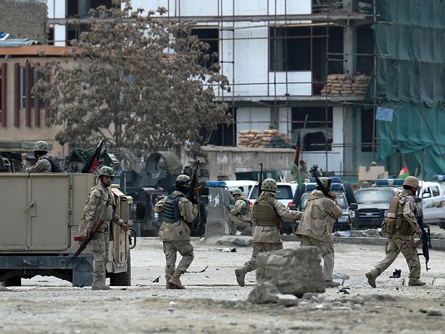 Military response ... Afghan members of a special reaction team are deployed at the scene.